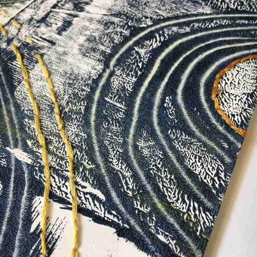 Detail monoprint and embroidery on paper